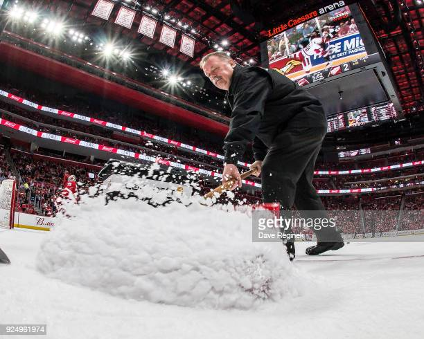Zamboni driver Al Sobotka shovels snow from the ice during a stoppage of play during an NHL game between the Detroit Red Wings and the Carolina...