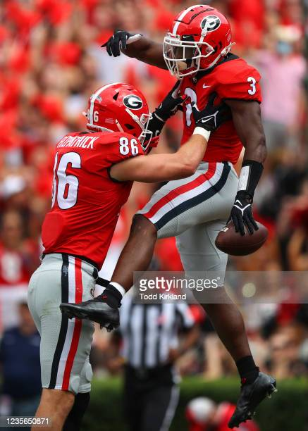 Zamir White of the Georgia Bulldogs reacts with John FitzPatrick after a touchdown in the first half against the Arkansas Razorbacks at Sanford...