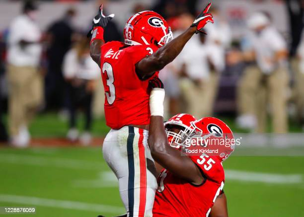 Zamir White of the Georgia Bulldogs reacts with Trey Hill after as touchdown during the second quarter of a game against the Auburn Tigers at Sanford...