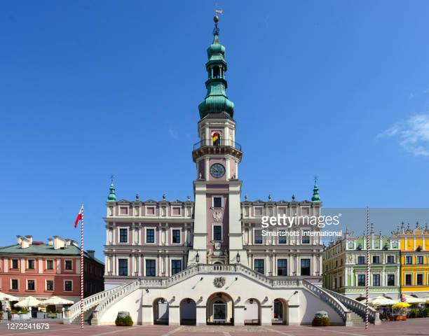 zamosc town hall facade in renaissance style on majestic rynek square with colorful armenian houses in zamosc, poland - poland stock pictures, royalty-free photos & images