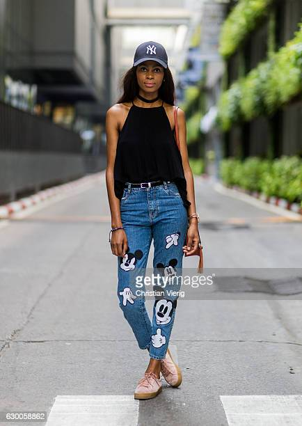 Zamzie is wearing a black Zara top blue patched denim jeans witch Micky Mouse pull bear sneaker mimco watch New York Yankees cap on December 16 2016...