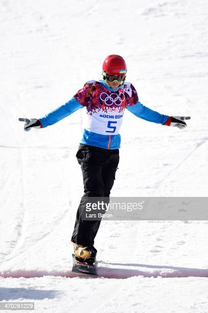 Zan Kosir of Slovenia wins the bronze medal in the Snowboard Men's Parallel Giant Slalom Finals on day twelve of the 2014 Winter Olympics at Rosa...