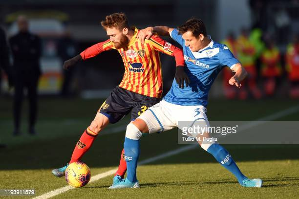 Zan Majer of Lecce and Ales Mateju of Brescia compete for the ball during the Serie A match between Brescia Calcio and US Lecce at Stadio Mario...