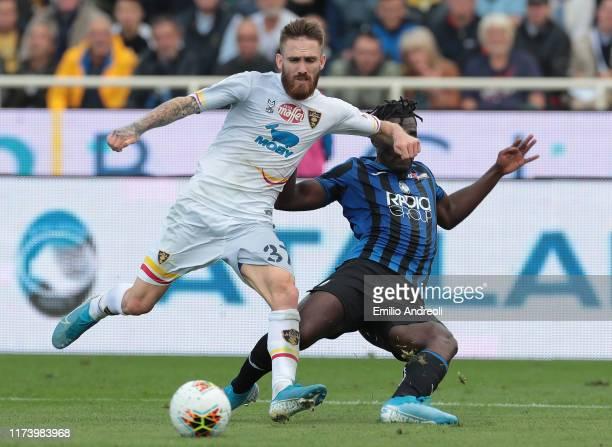 Zan Majer of US Lecce is challenged by Duvan Zapata of Atalanta BC during the Serie A match between Atalanta BC and US Lecce at Gewiss Stadium on...