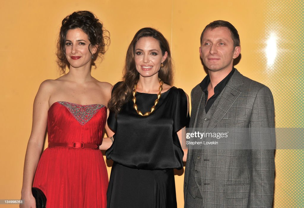 Zana Marjanovic, Angelina Jolie and Goran Kostic attend the premiere of 'In the Land of Blood and Honey' at the School of Visual Arts on December 5, 2011 in New York City.