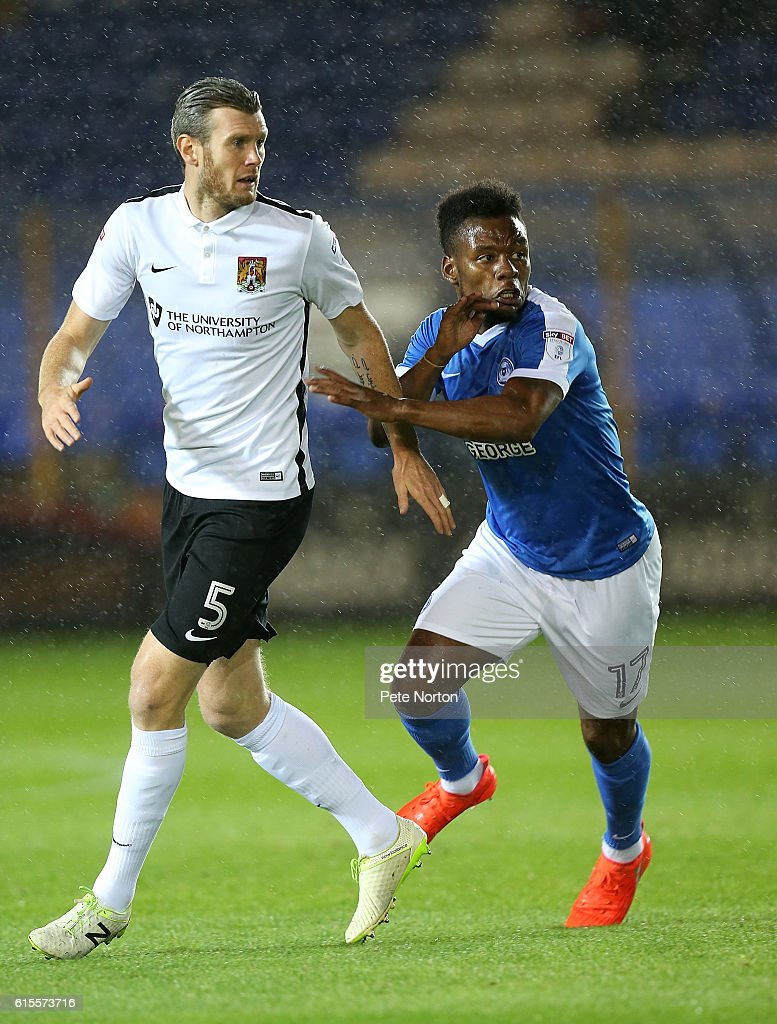 Zander Diamond of Northampton Town and Shaquile Coulthirst of Peterborough United in action during the Sky Bet League One match between Peterborough United and Northampton Town at ABAX Stadium on October 18, 2016 in Peterborough, England.