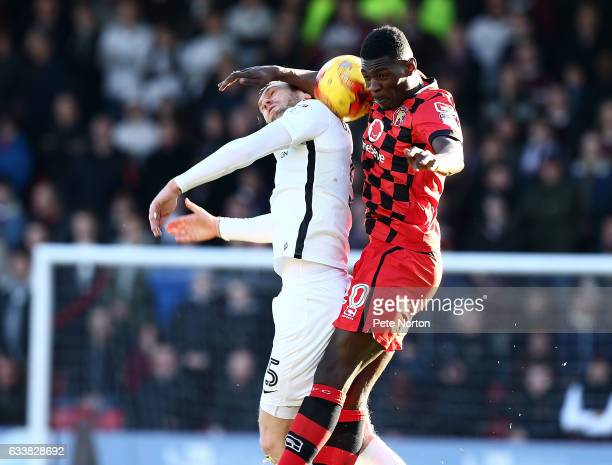 Zander Diamond of Northampton Town contests the ball with Amadou Bakayoko of Wallsall during the Sky Bet League One match between Walsall and...
