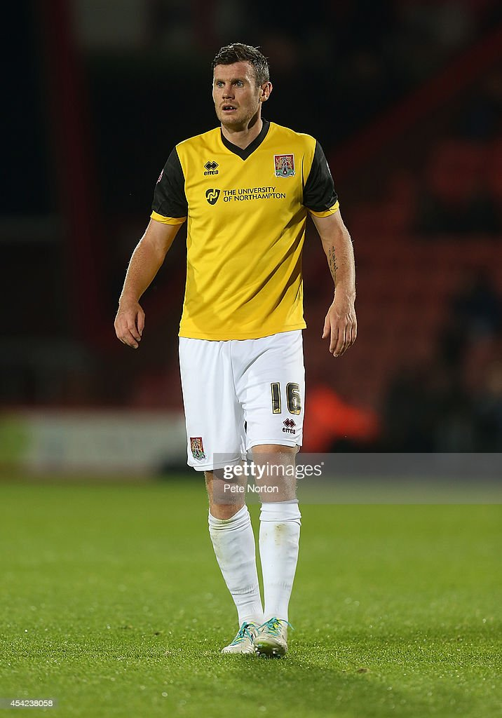 Zander Diamond of Northampton Town in action during the Capital One Cup Second Round match between AFC Bournemouth and Northampton Town at Goldsands Stadium on August 26, 2014 in Bournemouth, England.