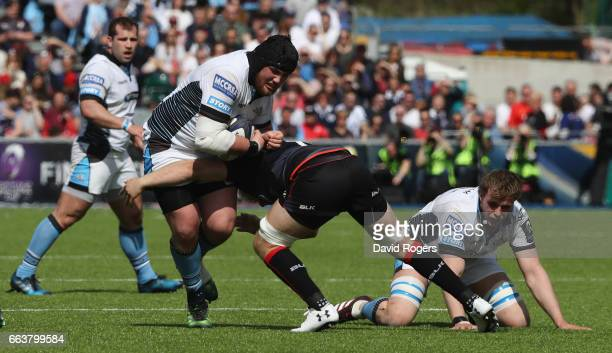 Zander Fagerson of Glasgow is tackled by Jackson Wray during the European Rugby Champions Cup match between Saracens and Glasgow Warriors at the...