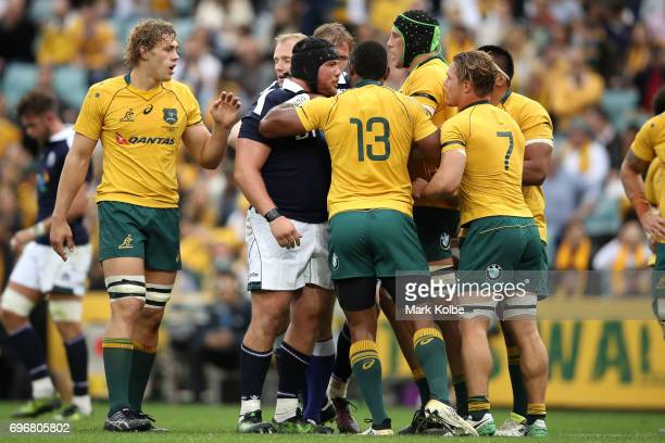 Zander Fagerson of Scotland and Michael Hooper of the Wallabies exchange heated words during the International Test match between the Australian...