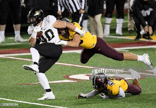 Zander Horvath of the Purdue Boilermakers carries the ball against Mariano Sori-Marin and Phillip Howard of the Minnesota Golden Gophers during the...
