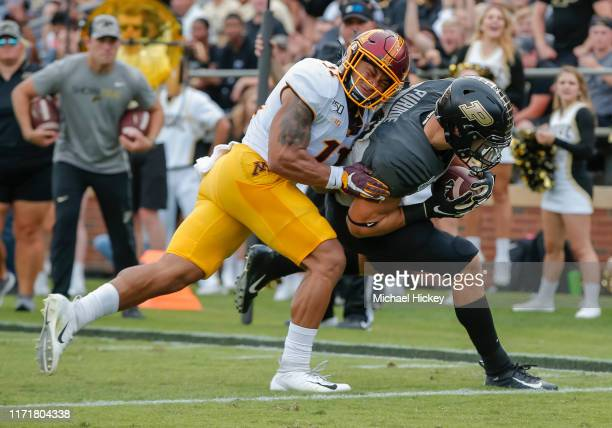Zander Horvath of the Purdue Boilermakers runs into the end zone for a touchdown as Antoine Winfield Jr #11 of the Minnesota Golden Gophers defends...