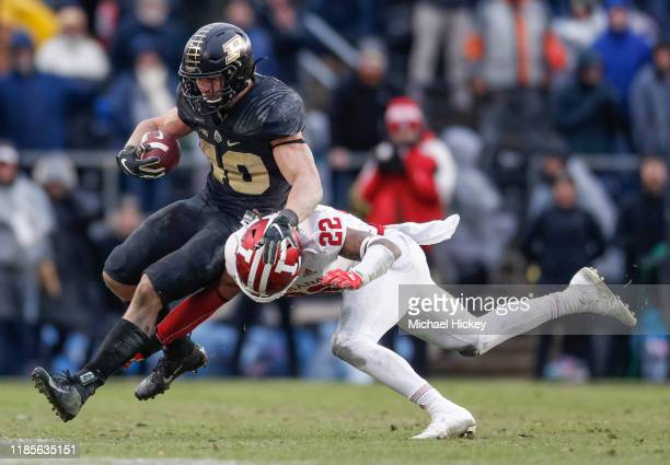 Zander Horvath of the Purdue Boilermakers runs the ball as Jamar Johnson of the Indiana Hoosiers makes the tackle in the second half at Ross-Ade...