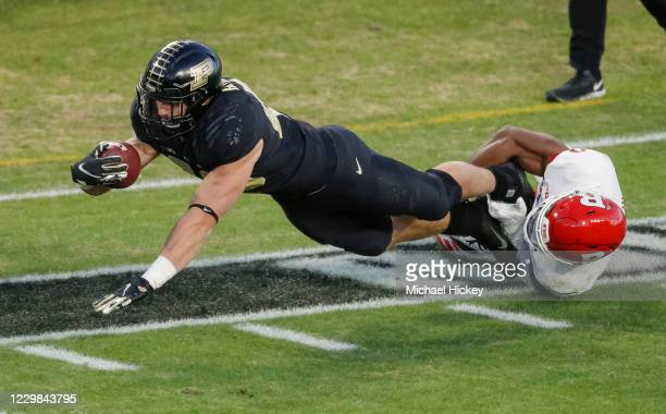 Zander Horvath of the Purdue Boilermakers stretches for yardage as Christian Izien of the Rutgers Scarlet Knights makes the tackle during the first...