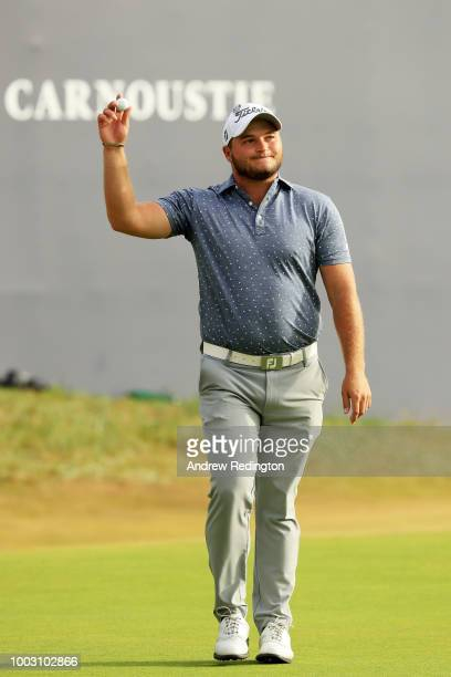 Zander Lombard of South Africa acknowledges the crowd after his eagle on the 18th hole during the third round of the 147th Open Championship at...