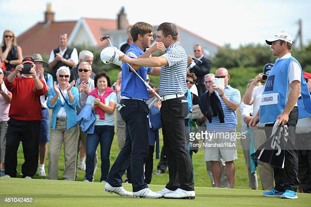 Zander Lombard of South Africa congratulates Bradley Neil of Blairgowrie after winning the final round of The Amateur Championship 2014 Day Seven at...