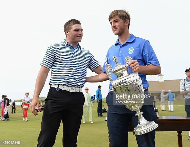 Zander Lombard of South Africa congratulates Bradley Neil of Blairgowrie with the trophy after winning the final round of The Amateur Championship...