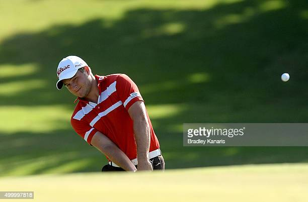 Zander Lombard of South Africa plays a shot on the 18th hole during day three of the 2015 Australian PGA Championship at Royal Pines Resort on...