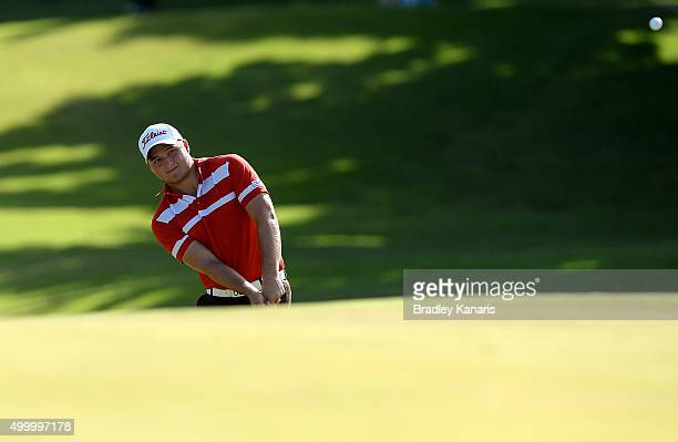 Zander Lombard of South Africa plays a shot onto the 18th green during day three of the 2015 Australian PGA Championship at Royal Pines Resort on...
