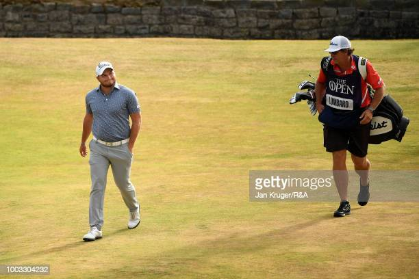 Zander Lombard of South Africa reacts after an eagle on the 18th hole during round three of the Open Championship at Carnoustie Golf Club on July 21...
