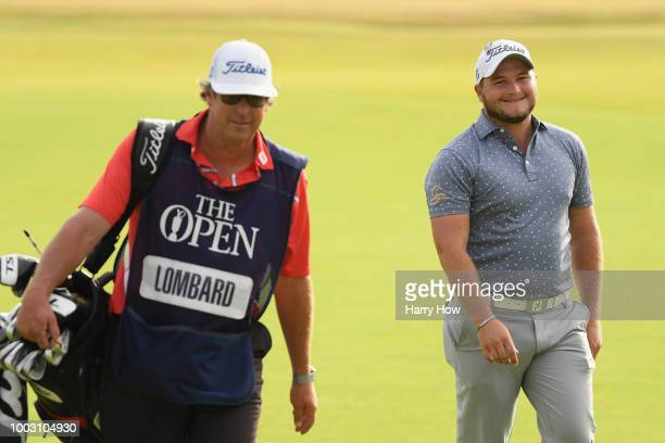 Zander Lombard of South Africa with his caddie Alan Burns after his eagle on the 18th hole during the third round of the 147th Open Championship at...