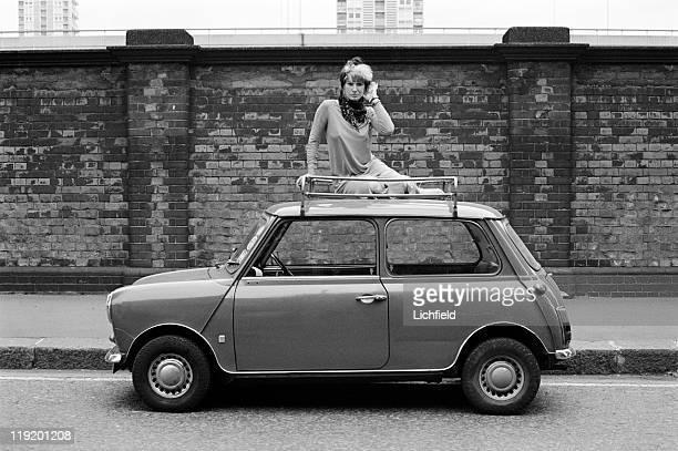 Zandra Rhodes on a Mini car British fashion designer 20th July 1977