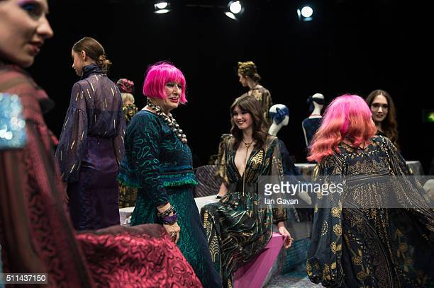 Zandra Rhodes poses with models at her Zandra Rhodes presentation during London Fashion Week Autumn/Winter 2016/17 at ICA on February 20 2016 in...