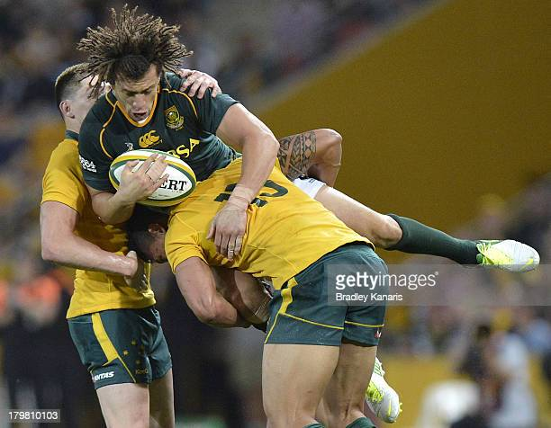 Zane Kirchner of the Springboks is picked up in the tackle by Israel Folau of the Wallabies during The Rugby Championship match between the...