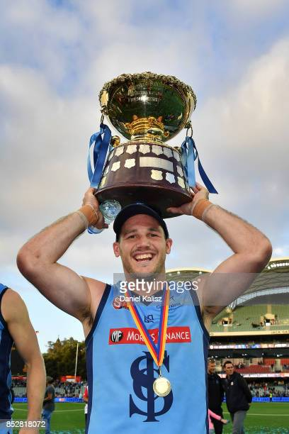 Zane Kirkwood poses for a photo with the Premiership Cup after defeating the Magpies during the SANFL Grand Final match between Port Adelaide and...