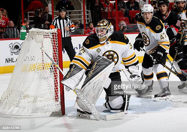 Zane McIntyre of the Boston Bruins deflects the puck away from the crease during an NHL game against the Carolina Hurricanes on January 8 2017 at PNC...