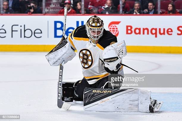 Zane McIntyre of the Boston Bruins gloves the puck during the NHL game against the Montreal Canadiens at the Bell Centre on November 8 2016 in...