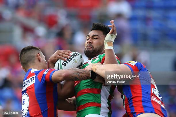 Zane Musgrove of the Rabbitohs is tackled by the Knights defence during the round three NRL match between the Newcastle Knights and the South Sydney...