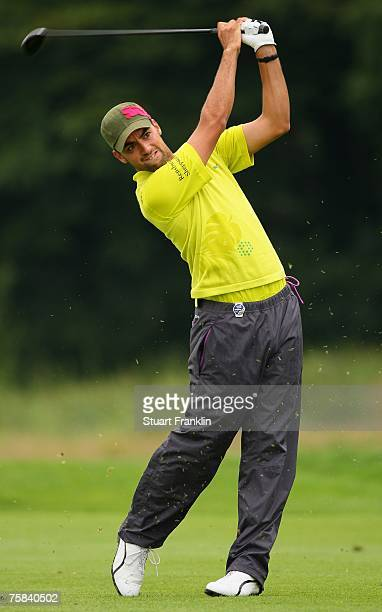 Zane Scotland of England plays his approach shot on the 17th hole during the third round of The Deutsche Bank Players Championship of Europe at Gut...