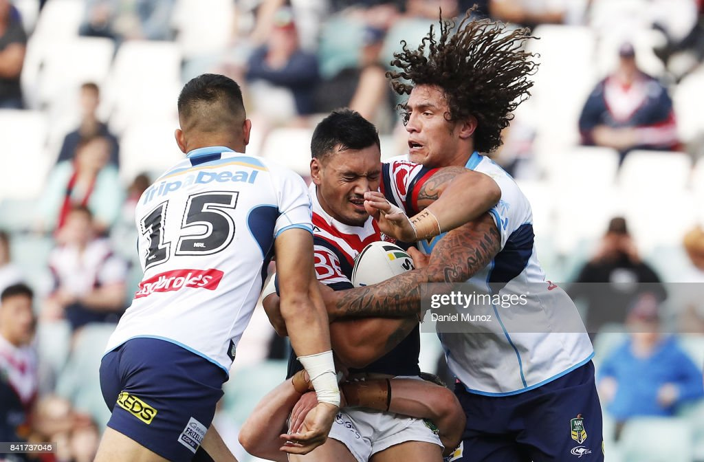 Zane Tetevano of the Roosters is tackled by Nathaniel Peteru and Kevin Proctor of the Titans during the round 26 NRL match between the Sydney Roosters and the Gold Coast Titans at Allianz Stadium on September 2, 2017 in Sydney, Australia.