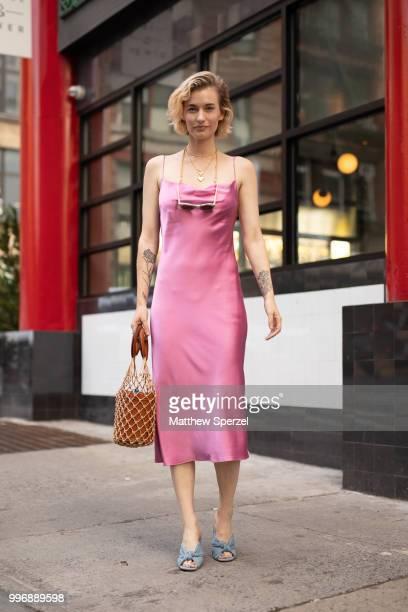Zanita Whittington is seen on the street during Men's New York Fashion Week wearing a pink Fleur du Mal dress on July 11, 2018 in New York City.