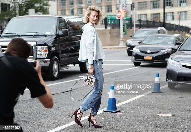 Zanita Whittington is seen outside the Altuzarra show wearing Bliss and Mischief blue jeans Senso purple shoes and Paula Cademartori bag during New...