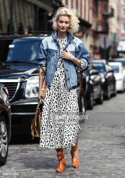 Zanita Whittington is seen wearing a jean jacket and animal print dress outside the Tibi show during New York Fashion Week Women's S/S 2018 on...