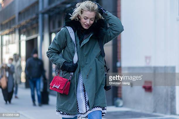Zanita Whittington is wearing a green parka and a red bag seen outside Tibi during New York Fashion Week Women's Fall/Winter 2016 on February 13 2016...