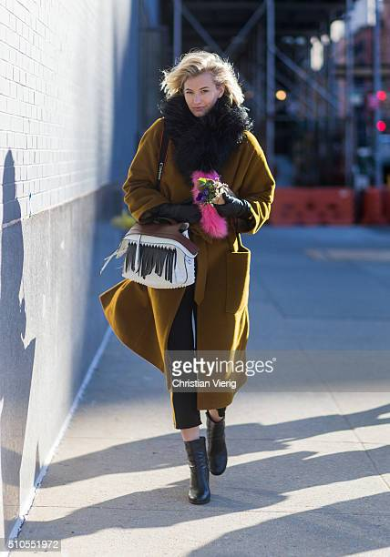 Zanita Whittington is wearing a wool coat black scarfs and a bag with black fringes seen outside J Crew during New York Fashion Week Women's...