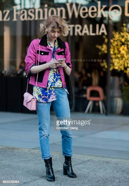 Zanita Whittington wearing a purple jacket, button shirt with floral print, denim jeans at day 2 during Mercedes-Benz Fashion Week Resort 18...