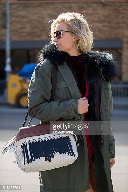 Zanita Whittington wears vintage sunglasses a Mr Mrs Italy green parka with a fur hood a red Zimmermann robestyle dress a Tod's wave bag during New...