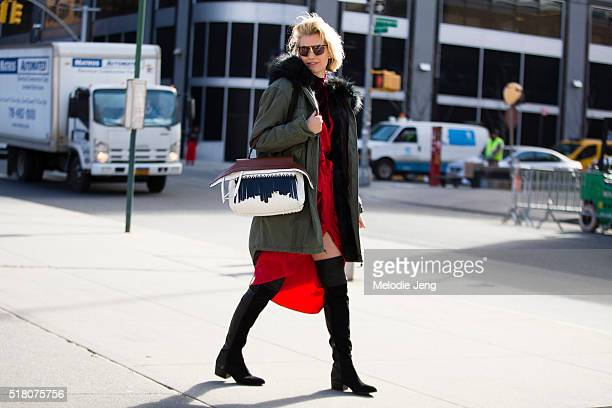Zanita Whittington wears vintage sunglasses a Mr Mrs Italy green parka with a fur hood a red Zimmermann robestyle dress a Tod's wave bag and Kurt...