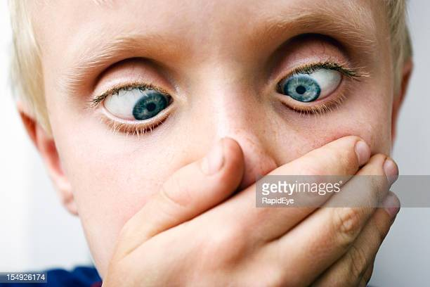 zany blond boy looks down, squinting - ugly kids stock photos and pictures