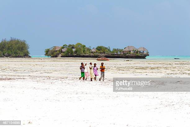 Zanzibarian Childrens walking on the beach