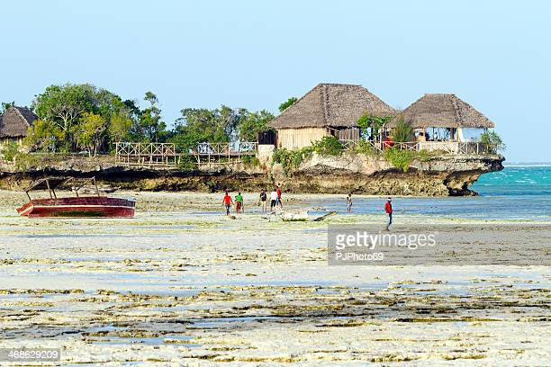 Zanzibarian's boys walking on the beach