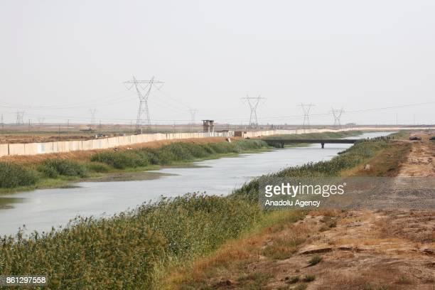 Zap river is seen as Iraqi security forces dig ditches with bulldozers meters away from Peshmerga site during the increasing tension between Hashd...