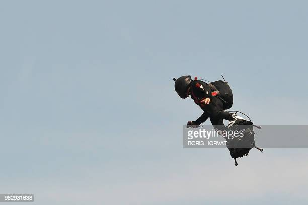 Zapata CEO Franky Zapata flies a jetpowered hoverboard or 'Flyboard' on June 24 2018 ahead the Formula One Grand Prix de France at the Circuit Paul...