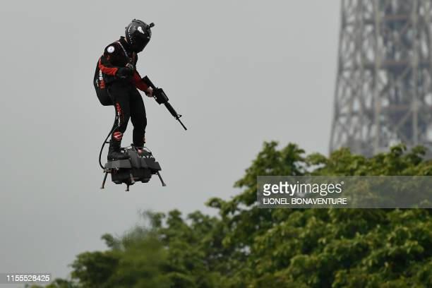 Zapata CEO Franky Zapata flies a jetpowered hoverboard or Flyboard prior to the Bastille Day military parade down the ChampsElysees avenue in Paris...