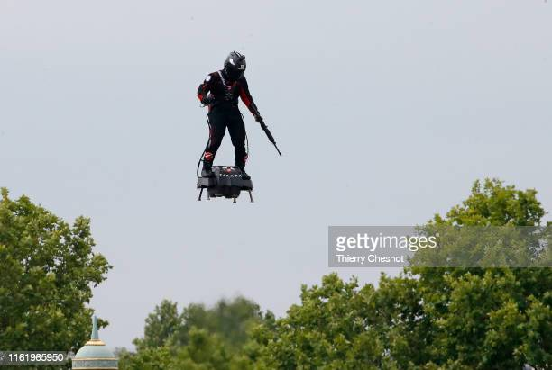 Zapata CEO Franky Zapata flies a jetpowered hoverboard or Flyboard during the traditional Bastille Day military parade on the ChampsElysees avenue...