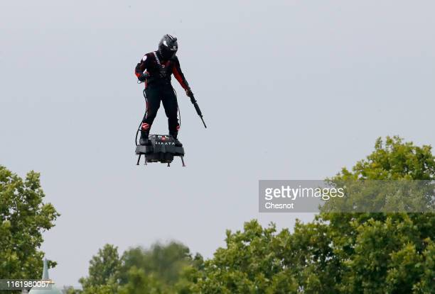 """Zapata CEO Franky Zapata flies a jet-powered hoverboard or """"Flyboard"""" during the traditional Bastille Day military parade on the Champs-Elysees..."""